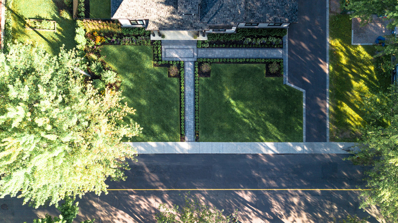 Aerial photo of landscaping, tree services, and concrete done by DLC Teams