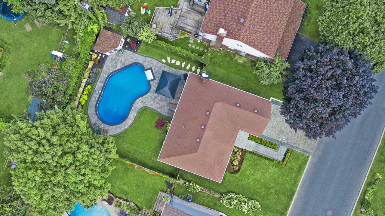 Aerial photo of landscaping, concrete and tree services done by DLC Teams