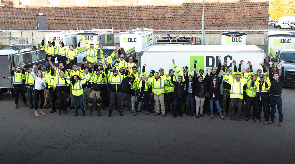 Action photo of DLC teams in the parking lot facing their trucks