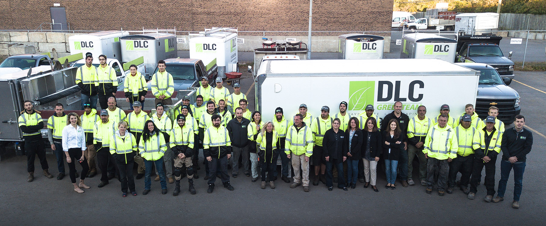 Photo of DLC Teams in their parking lot